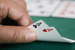 Close up of pair of aces on poker table Stock Photos