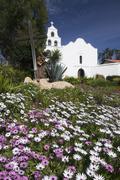 Meadow with church in background, Mission San Diego de Alcala, San Diego, - stock photo