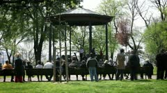 People gathering in pavilion Stock Footage