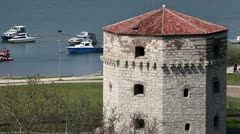 Zoom in of old tower on Sava river Stock Footage