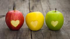 Apples with engraved hearts Stock Photos