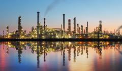 Oil and gas refinery at twilight with reflection - factory - petrochemical pl Stock Photos