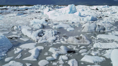Aerial view Knik Glacier ice flows Knik River Alaska, USA Stock Footage