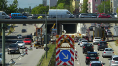 T/L Roadworks Traffic Congestion in construction site in German city Stock Footage