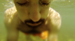 Young Man Swimming Underwater Stock Footage