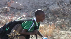 Smiling boy hikes with backpack. Stock Footage