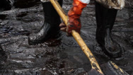 Stock Video Footage of OIL SPILL DISASTER BLACK SLUDGE
