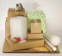 Shipping boxes and packing supplies Stock Photos