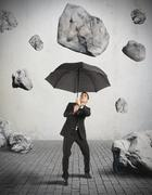 shelter from the storm of crisis - stock photo
