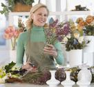 Stock Photo of Female florist cutting flowers