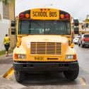 Stock Photo of yellow school bus parked