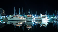 Expensive Boats mored on calm night in Sydney Harbour 245GYDH PAL Stock Footage