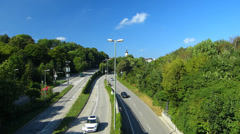 Germany Munich Middle Ring Traffic Greenery n Tree along the road Stock Footage