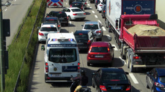 T/L Ambulance stuck in Rush-hour Commute Traffic Roadworks Europe German city - stock footage