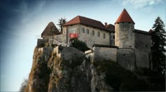 Castle on hill above Bled in Slovenia - stock footage
