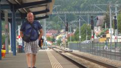 Man, Tourist, Passenger Waiting for Train in Railway Station for Traveling Stock Footage