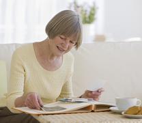 Senior woman looking at photo album Stock Photos