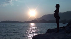 Silhouette of Pregnant on a rock Stock Footage