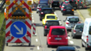 Stock Video Footage of Out-Focus Rush-hour Commute Traffic Roadworks construction urban Europe German