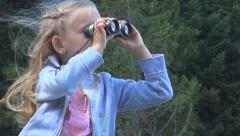 Child Looking in Binocular, Spyglass in Mountains Forest ,Tourist Girl in Trip Stock Footage