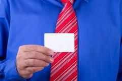 Stock Photo of businessman showing business card