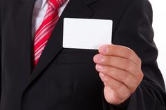 Stock Photo of businessman shows blank business card