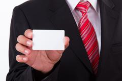 businessman shows blank business card - stock photo