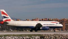 British airways jet taxies on runway Stock Footage