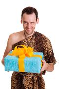 sincere gift from wild funny man - stock photo