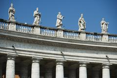 Statues on colonnade at St. Peter?s Basilica, Italy - stock photo