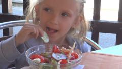 Child Eating Salad without Cutlery, Girl at Restaurant, Bar, House , Children Stock Footage