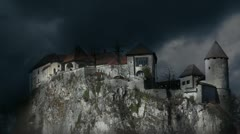 Bled's castle with stormy clounds - stock footage
