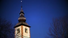 Upper part of church tower with sky that has color correction Stock Footage