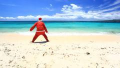 Santa claus on tropical beach - stock footage