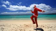 Stock Video Footage of Happy santa claus on tropical beach