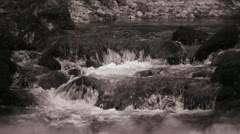 Stil river rapids in greyscale Stock Footage