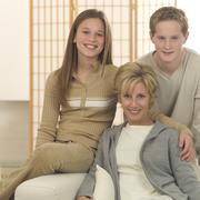 A mother with her two children Stock Photos