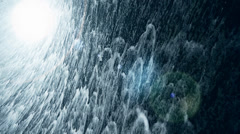 Torrential waterfall & spray with light. Stock Footage