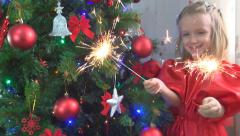 Child, Little Girl Holding a Burning Fireworks by a Christmas Tree, Children Stock Footage