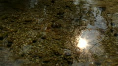 Shot of sun shining reflected on water surface Stock Footage