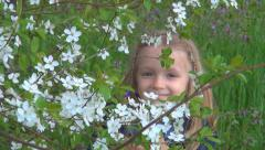 Child Smiling in Camera Hiding between Spring Flowers, Fruits Blooming Trees Stock Footage