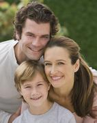 Stock Photo of Portrait of family with one child