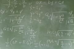 Blackboard with math equations - stock photo