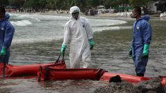 OIL SPILL DISASTER WORKERS BOOM Stock Footage