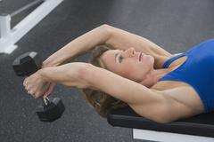 Woman exercising with weight - stock photo
