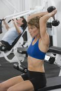 Stock Photo of Woman exercising with weight
