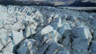 Stock Video Footage of Aerial view of natures Knik Glacier moraine crevasses  Alaska, USA