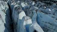 Stock Video Footage of Aerial view Knik Glacier moraine crevasses feeding the Knik River, Alaska, USA