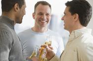 Stock Photo of Multi-ethnic men drinking beer