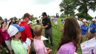 Stock Video Footage of Phil Mickelson signing autographs.